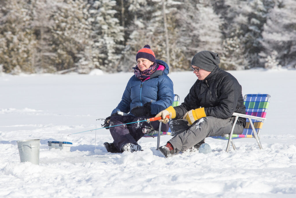 a mother and son go ice fishing